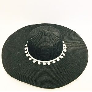 Black and white floppy beach hat weaved